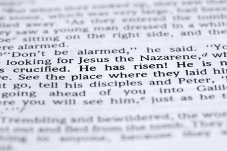 Open Bible with selective focus on text in Mark 16:6 about Jesus' resurrection. Shallow DOF Stock Photo - 8562121