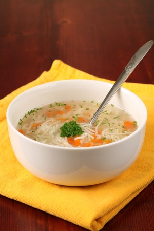 chicken noodle: Turkey or chicken soup with carrot, noodles and parsley Stock Photo