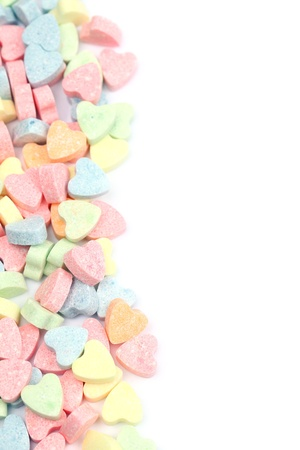 Border made of little colorful candy hearts photo
