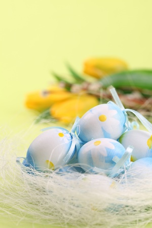 Blue Easter eggs and yellow tulips on a green background Stock Photo - 8664458
