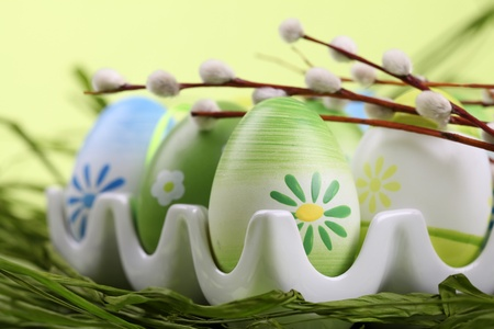 Colorful Easter eggs in an egg holder. Shallow dof photo