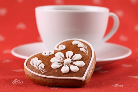 decaffeinated: Gingerbread heart and a cup of coffee. Shallow dof Stock Photo