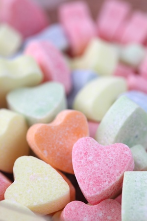 Little colorful candy hearts background. Shallow dof