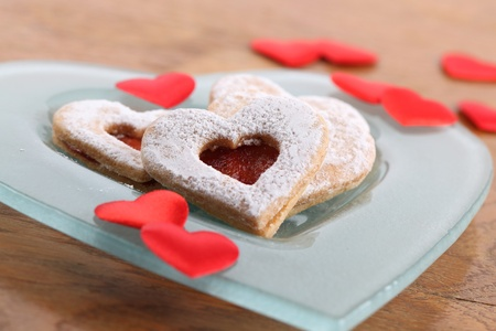 Shortbread hearts and heart shaped confetti on a plate photo
