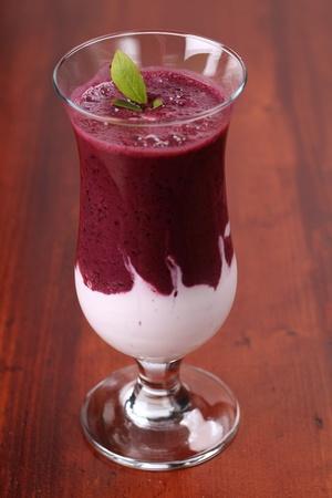 Fresh blueberry milk shake with sour cream. Shallow DOF.  photo