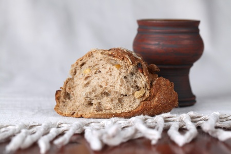 Bread and chalice with wine. Shallow dof, copy space photo