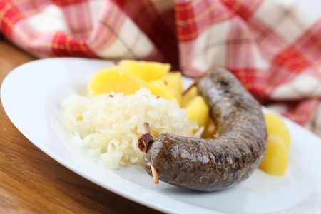 Traditional Czech white pudding made of pork, groats and various spices with potatoes and sauerkraut Stock Photo - 8772171