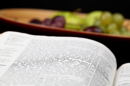 Holy Bible open to Galatians 5. Focus on verse 22. Fruit of the Spirit Stock Photo - 8878191