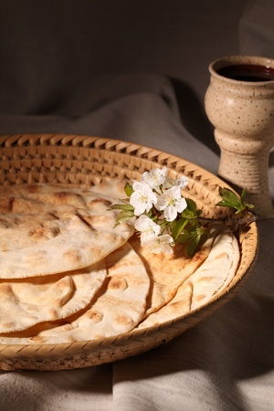 Chalice with red wine and pita bread in a basket Stock Photo - 8878262