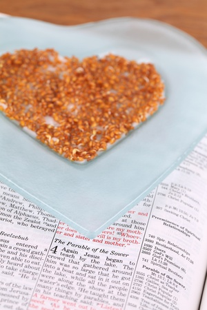 parable: Bible open to Mark 4 with focus on the Parable of the Sower and a heart shaped plate with cress sprouts