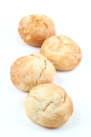 breadloaf: Four fresh buns isolated on white background