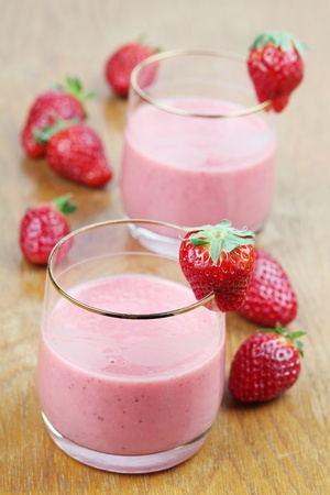 Fresh strawberry milk shake in two glasses photo