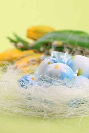 Blue Easter eggs and yellow tulips on a green background Stock Photo - 8989450