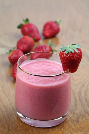 Fresh strawberry milk shake in a glass photo