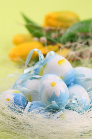 Blue Easter eggs and yellow tulips on a green background Stock Photo - 9074497
