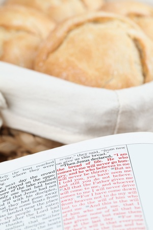 Bible open to John 6:35. Jesus being the bread of life. Shallow dof photo