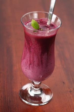 Blueberry milk shake with sour cream. Shallow DOF.  photo