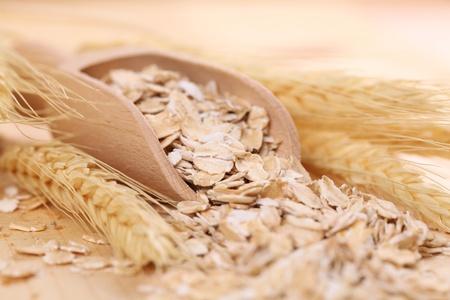 wooden scoop: Wooden scoop with oats Stock Photo