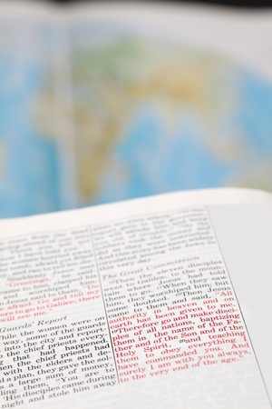 disciples: Open Bible with selective focus on the text in Matthew 25 - Great Commission. Jesus is sending and commissioning his disciples to continue His work. World missions concept. Stock Photo
