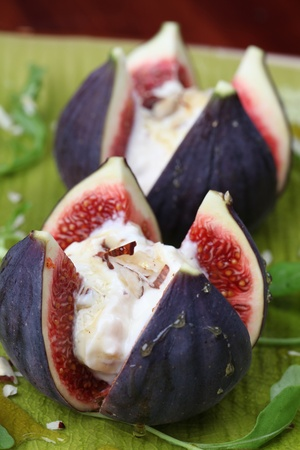 Figs with nut and honey cheese. Shallow dof photo