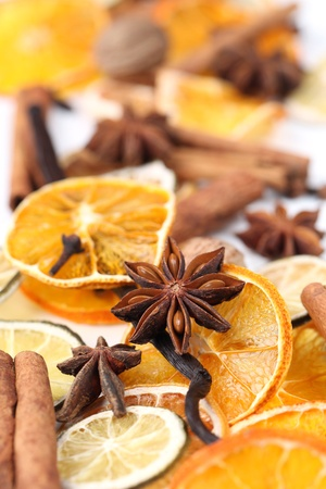 Christmas background with Christmas spices and dried orange slices photo