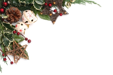 Christmas border with jingle bells, stars and other Christmas ornaments and decorations isolated on white. Shallow dof Stock Photo - 11480165