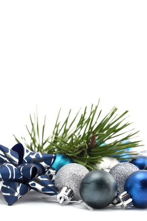 Fancy bow with blue and silver Christmas ornaments and a pine twig isolated on white background. Shallow dof Stock Photo - 11480951