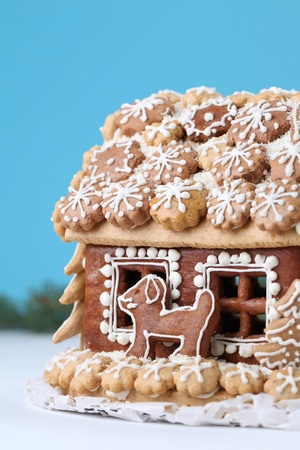 Christmas gingerbread house on blue background. Shallow dof photo