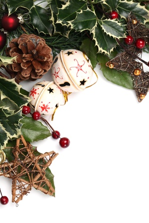 Christmas border with jingle bells, stars and other Christmas ornaments and decorations isolated on white. Shallow dof photo