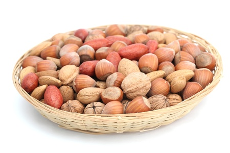 Basket with hazelnuts, walnuts, almonds and pecans  photo