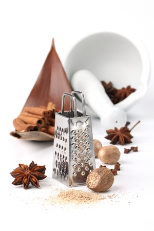 Spices, grater and mortar photo