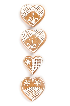 Gingerbread hearts on white background photo