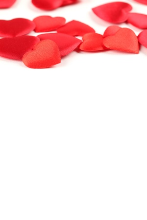 Border made of heart shaped decorations on white background photo
