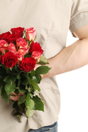 gift behind back: Man holding a bouquet of roses behind his back