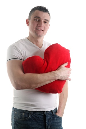Man with a heart shaped pillow isolated on white background Stock Photo - 12199949
