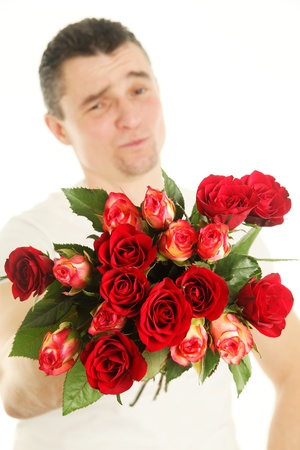 Man with a bouquet of red roses isolated on white background photo