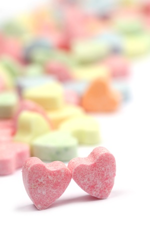 Little colorful candy hearts on white background. Shallow dof photo