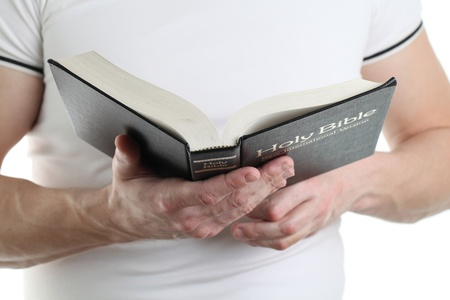 Man reading the Bible. Focus on the Bible photo