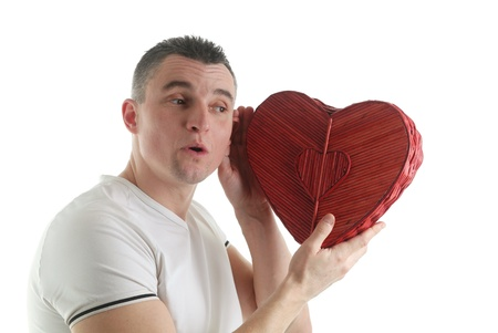 Man with a heart shaped box isolated on white background photo