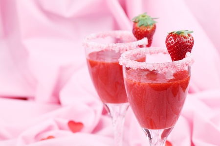 Fresh strawberry drink in wine glasses. Shallow dof photo