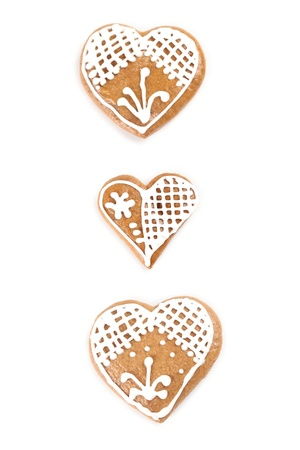 Gingerbread hearts isolated on white background photo