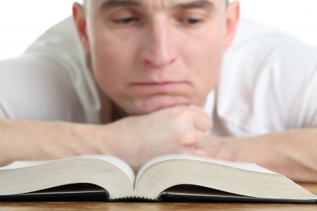 Man studying the Bible. Focus on the Bible photo