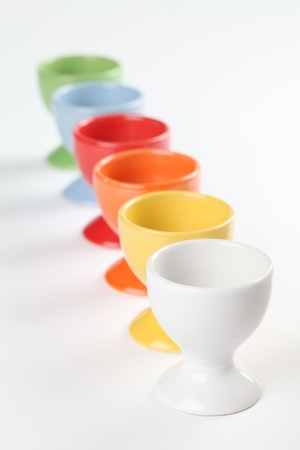 Close-up of a row of colorful eggcups. Shallow dof Stock Photo - 12200006