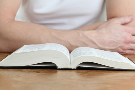 Man studying the Bible. Focus on the Bible Stock Photo - 12200009