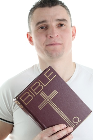 Man holding the Holy Bible, isolated on white background photo