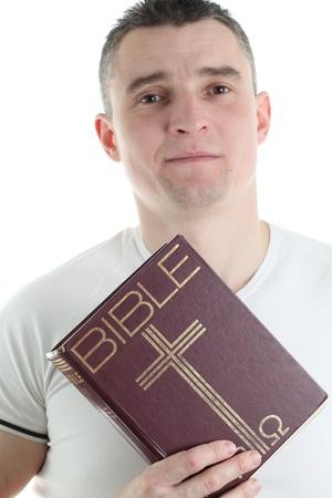 Man holding the Holy Bible, isolated on white background Stock Photo - 12542730