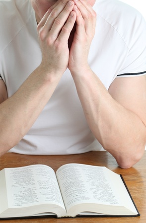 soul searching: Man praying with the Bible