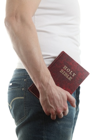 man holding book: Man holding the Holy Bible, isolated on white background