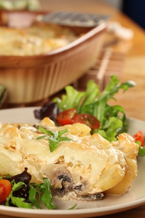 casserole: Potato gratin with mushrooms, eggs, cheese and mixed greens