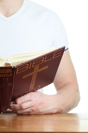 holding bible: Man reading the Bible  Focus on the Bible